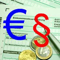 """German tax form """"Einkommensteuererklärung"""" with euro coins and pen"""